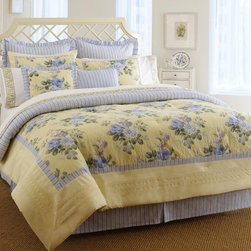 "Laura Ashley Home - Caroline Bed in a Bag - Laura Ashley Caroline is a beautiful floral print featuring yellow and blue accented with and ticking stripes. The Comforter set includes the Comforter, Shams & bedskirt. Complete the ensemble with designer accessories including drapes, euro shams and decorative pillows. Features: -Comforter Set includes comforter, two shams (twin set includes one sham), and tailored bed skirt. -100% pieced cotton. -Bedskirt is tailored with 5 pleats, split corners with overlap, in ticking stripe. -300 thread count matte weave. -Machine washable. Specifications: -Twin comforter: 63"" W x 86"" L. -Twin bed skirt (14"" drop): 39"" W x 75"" L. -Standard Sham: 20"" W x 26"" L. -Queen comforter: 90"" W x 90"" L. -King comforter: 95"" W x 109"" L."