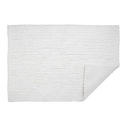 Reversible White Bath Rug - Luxurious, highly absorbent 3,000-gram cotton rugs are looped on one side, sheared on the other for twice the plush.