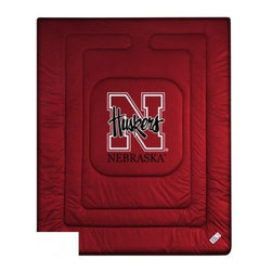 Sports Coverage - Nebraska Cornhuskers Bedding - NCAA Comforter - Full - Show your team spirit with this great looking officially licensed University of Nebraska Cornhuskers comforter. This Cornhuskers comforter is made from 100% Polyester Jersey Mesh - just like what the players wear. The fill is 100% Polyester batting for warmth and comfort. Featuring authentic Nebraska Cornhuskers team colors, each comforter has the authentic University of Nebraska Cornhuskers logo screen printed in the center. Soft but durable. Machine washable in cold water. Tumble dry in low heat. Covers are 100% Polyester Jersey top side and Poly/Cotton bottom side. Each comforter has the team logo centered on solid background in team colors. 5.5 oz. Bonded polyester batts. Looks and feels like a real jersey!