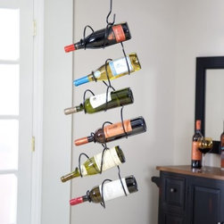 Oenophilia Climbing Tendril 6-Bottle Wine Rack - The Oenophilia Climbing Tendril Wine Rack - Black features intertwining tendrils to perfectly hold your wine. It is made of metal with black finish. This product requires minor assembly and includes a wall bracket ceiling hook and one extender rod. Each of these pieces matches the finish you choose. The ceiling hook that is included should be secured into a ceiling joist to hold the weight of the rack or use the wall bracket for quick and easy installation on your wall. Dimensions: 30L x 6W x 3D inches.