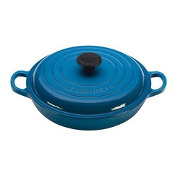 "Le Creuset - Le Creuset Signature 5 qt.. Braiser - Colorful, long-lasting exterior enamel resists chipping and cracking; interior enamel is engineered to resist staining and dulling. Sand-colored interior enamel makes it easy to monitor food as it cooks, preventing burning and sticking. Oversized handles provide even weight distribution and a secure grip. Ergonomic composite knobs are heat resistant to 500F. Built"" lid stabilizers provide a secure, no-slide fit. The lightest weight per quart of any premium cast iron cookware available. Compatible with Gas, Electric, Ceramic, Halogen, Induction, Oven & Outdoor Grill. Dishwasher safe. Lifetime warranty.. Made in France."