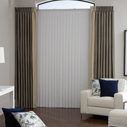 Curtains & Draperies of Indianapolis- Custom Styles at Affordable Prices - This is a picture of seamed draperies layered over vertical sheer shades.  This is a great option to provide color around your patio door or large windows.