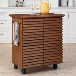 Home Styles - Home Styles Cascade Louvred Kitchen Cart Multicolor - 5454-95 - Shop for Carts from Hayneedle.com! The Home Styles Cascade Louvred Kitchen Cart gives even the smallest kitchens extra storage and work space. Constructed of durable hardwood solids and veneers in a warm oak finish this portable kitchen cart features a hidden-touch latch door cabinet. One side opens to reveal an adjustable shelf while the other side has three drawers to keep utensils mixing bowls measuring cups and other items organized and within easy reach. Featuring a shutter-style design for added style and visual interest this kitchen cart is equipped with a dish towel rack as well as caster wheels to make it easy to move wherever you need it. The smooth durable wood top is perfect for prepping food or serving drinks and appetizers when entertaining guests. Slide-out trays on each end extend the work surface to 52 inches wide. About Home StylesHome Styles is a manufacturer and distributor of RTA (ready to assemble) furniture perfectly suited to today's lifestyles. Blending attractive design with modern functionality their furniture collections span many styles from timeless traditional to cutting-edge contemporary. The great difference between Home Styles and many other RTA furniture manufacturers is that Home Styles pieces feature hardwood construction and quality hardware that stand up to years of use. When shopping for convenient durable items for the home look to Home Styles. You'll appreciate the value.