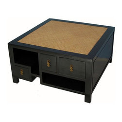 Rattan top coffee table - The coffee table featured here has a rattan top, smooth and lustrous black lacquer finished sides, and multi-purpose storage space. With its Asian flair, this piece is sure to make an impression.