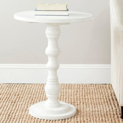 Safavieh Greta Accent Table - No matter which finish you choose, the Safavieh Greta Accent Table is sure to light the way to sleek, original style. The traditional look of the candlestick base is updated by an array of vibrant choices. The perfect place to sit your book or a favorite accessory, it's gorgeous in any room. Available in Ash Grey, Dark Teal, Gold, Off White, or Silver.About SafaviehConsidered the authority on fine quality, craftsmanship, and style since their inception in 1914, Safavieh is most successful in the home furnishings industry thanks to their talent for combining high tech with high touch. For four generations, the family behind the Safavieh brand has dedicated its talents and resources to providing uncompromising quality. They hold the durability, beauty, and artistry of their handmade rugs, well-crafted furniture, and decorative accents in the highest regard. That's why they focus their efforts on developing the highest quality products to suit the broadest range of budgets. Their mission is perpetuate the interior furnishings craft and lead with innovation while preserving centuries-old traditions in categories from antique reproductions to fashion-forward contemporary trends.