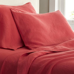 Lino Coral Linen Queen Flat Sheet - Super soft, washed bedding in solid, gorgeous hues spreads the bed in the comforting touch and relaxed, worn-in style of pure linen.