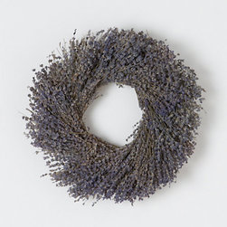 Lavender Wreath - Summertime wreaths add a welcoming flair to homes. This lavender wreath can also be displayed indoors, releasing scents of lavender.