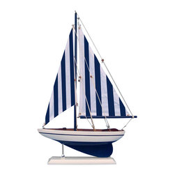 Handcrafted Nautical Decor - Nautical Sailer - NOT A MODEL SHIP KIT   --Attach Sails and this Sailboat Centerpiece is Ready for Immediate Display ---- --Brighten  your day, or any room of your home, with   this delightfully fun  Pacific Sailboat model. Perfect nautical Decor gifts for friends,    children, or party guests, they also make excellent nautical decorations  or sailboat centerpieces for a reception or group event. Liven your  office, beach   house, or sunroom with one of these colorful sailboat  models today! --------    Handcrafted solid wood hull, masts and stand with metal supports--    Timeless nautical colors - Navy blue and white--    Largest sailboat selection available - We offer over 150 unique model sailboats --    Featured in Sept 2011 Brides magazine - Excellent wedding table centerpiece--    --    Perfect nautical gift for friends, children or party guests--    --    Ideal for banquets, receptions, meetings, or any other nautical party or event ---- Contact us for quantity discounts---- --This model sailboat requires minor assembly. Simply insert mast into hull and clip on the sails. --There is no rigging to tie or tighten. Assembly takes less than 2 minutes.