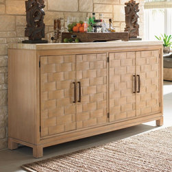 Lexington - Tommy Bahama by Lexington Home Brands Road to Canberra Newcastle Buffet Multicol - Shop for Buffets and Side Boards from Hayneedle.com! The Newcastle Buffet showcases your favorite pieces and keeps everything organized. Constructed of durable wood this buffet features four doors with easy-pull handles. Behind the woven veneer doors are four adjustable shelves two felt-lined drawers and one with silver dividers. Handy! The expansive honed travertine top offers a practical and beautiful surface for display.About Lexington Home BrandsFounded in 1903 in High Point NC Lexington Home Brands has become a globally known manufacturer and marketer of unique home furnishings. They are an industry leader in design style and quality products. Their product line consists of upholstered and hardwood furniture under recognized brands such as Lexington Tommy Bahama Sligh and Henry Link Trading Co.. Lexington Home Brand's intentions and aspirations are to create exclusive designs and styles that accommodate the traditional contemporary casual and formal decors of their customers' homes.