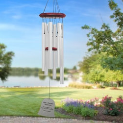 Chimes of Your Life Personalized Bell Wind Chime - Hand-tuned to ancient pentatonic notes the Chimes of Your Life Personalized Bell Wind Chimes produce a calm soothing sound that relaxes your body and mind and brings a sense of tranquility to your surroundings. But what sets these personalized wind chimes apart from the rest is that each bell wind chime is engraved with your own thoughts and feelings and custom made just for you! Each side of the chime's wind sail can be inscribed with up to 300 characters (per side) of text. Your personal message is expertly engraved on both sides of the silver or bronze wind sail in black creating a high-contrast easy-to-read inscription. A professional graphic artist chooses the formatting spacing between paragraphs centering and font size based on the wind sail design and content of your inscription creating the perfect wind chime for you. The top pieces and strikers of these chimes are made of Ash hardwood stained in beautiful warm red and finished with clear semi-gloss polyurethane to protect the wood for years to come. The pentatonic-tuned tubes are made of non-rusting anodized aluminum and coated with a lasting weather-resistant bronze or silver finish. The acrylic bell-shaped wind sail comes in matching silver or bronze. Available in 19-inch 29-inch or 39-inch overall lengths. An excellent way to remember special days and people the Chimes of Your Life Personalized Bell Wind Chimes make thoughtful gifts that are sure to be cherished for years to come. Personalization: A professional graphic designer will format your message to fit the wind sail perfectly based on all elements - sail shape and the content of your inscription. Inscription is limited to a maximum of 300 characters (per side). Wind sail area provides enough space for a small poem. Message will be engraved on both sides. Personalized wind chimes make appropriate gifts for weddings anniversaries retirement and memorials for people or pets. Wind Chime Length: The 
