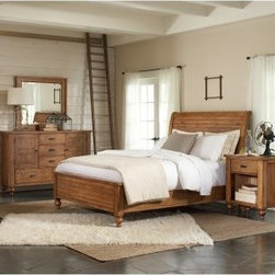 Riverside Summerhill Sleigh Bed with Storage - The Riverside Summerhill Sleigh Bed with Storage features the woodsy charm and craftsmanship you expect but with a convenient little surprise. The pine solid and pine veneer construction is beautifully finished in a distressed Canby rustic pine for just the right touch. The complete platform bedding support includes wood legs with built-in leveler for maximum stability while two drawers provide added storage so you can stow away anything with ease. Notes on Riverside ConstructionAll Riverside domestic furniture is constructed of fine oak ash poplar and pine wood. These wood types are durable and feature beautiful open grains that make them much preferred among furniture manufacturers. Each piece of wood is first graded for quality then kiln-dried to remove excess moisture and prevent splitting. The wood is then constructed into a high-quality furniture piece using a combination of hardwood solids and hand-selected veneers. Techniques used on Riverside pieces include dovetail joinery heavy-duty drawer roller guides and multi-step finish applications that include hand-sanding and polishing for a deep lustrous result. All Riverside furniture is given this high-quality treatment to ensure the beauty and durability of your final product. About Riverside FurnitureRiverside has been growing for more than half a century. The company's founder Herman Udouj opened the doors to his first factory in 1946 and along with 12 employees he began making handcrafted furniture for the post-World War II Baby Boom era. Since then generations of customers have furnished their homes and offices with Riverside's wide range of furniture products. Riverside strives to be trusted for quality products that are an affordable value. It's just that simple.