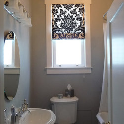 Black and White Roman Shade in the Bathroom - A graphic print in black and white, on a roman shade is perfect in a small Noe Valley, San Francisco bath. Stitch Custom Furnishings