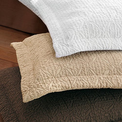 Olivia Matelasse Shams - Euro Shams - White - Elegant and nostalgic, the Olivia Matelasse Shams have a distinctive, timeless look that suits every nationality of decor with equal grace. These neutral shams' tone-on-tone quilting extends over the surface of the pillow insert and to the edge of the neat flange that borders them. Geometric designs become exquisite in these stunning neutral quilted pillow shams.