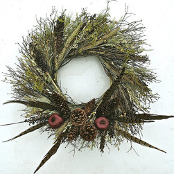 """Frontgate - Ringtail Woods Wreath - 20"""" dia. - Organic. All-natural. Crafted of ringtail pheasant feathers, quail brush, green millet, black sorghum, moss, linum, oats and green wheat. Suitable for indoor use or outdoor use in a protected area. Nature's elegance is personified in our elaborate Ringtail Woods Wreath. Quail brush, green millet, black sorgum, moss, linum, oats and green wheat make a spectacularly textured base for the long, bristly ringtail pheasant feathers that burst forth. Hang this foliage above a fireplace or in an entryway for an added organic touch in your home.  .  .  .  . Made in the USA."""