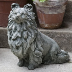 Campania International Sheltie Dog Cast Stone Garden Statue - About Campania InternationalEstablished in 1984, Campania International's reputation has been built on quality original products and service. Originally selling terra cotta planters, Campania soon began to research and develop the design and manufacture of cast stone garden planters and ornaments. Campania is also an importer and wholesaler of garden products, including polyethylene, terra cotta, glazed pottery, cast iron, and fiberglass planters as well as classic garden structures, fountains, and cast resin statuary.Campania Cast Stone: The ProcessThe creation of Campania's cast stone pieces begins and ends by hand. From the creation of an original design, making of a mold, pouring the cast stone, application of the patina to the final packing of an order, the process is both technical and artistic. As many as 30 pairs of hands are involved in the creation of each Campania piece in a labor intensive 15 step process.The process begins either with the creation of an original copyrighted design by Campania's artisans or an antique original. Antique originals will often require some restoration work, which is also done in-house by expert craftsmen. Campania's mold making department will then begin a multi-step process to create a production mold which will properly replicate the detail and texture of the original piece. Depending on its size and complexity, a mold can take as long as three months to complete. Campania creates in excess of 700 molds per year.After a mold is completed, it is moved to the production area where a team individually hand pours the liquid cast stone mixture into the mold and employs special techniques to remove air bubbles. Campania carefully monitors the PSI of every piece. PSI (pounds per square inch) measures the strength of every piece to ensure durability. The PSI of Campania pieces is currently engineered at approximately 7500 for optimum strength. Each piece is air-dried and then de-molded by hand. After an internal quality check, pieces are sent to a finishing department where seams are ground and any air holes caused by the pouring process are filled and smoothed. Pieces are then placed on a pallet for stocking in the warehouse.All Campania pieces are produced and stocked in natural cast stone. When a customer's order is placed, pieces are pulled and unless a piece is requested in natural cast stone, it is finished in a unique patinas. All patinas are applied by hand in a multi-step process; some patinas require three separate color applications. A finisher's skill in applying the patina and wiping away any excess to highlight detail requires not only technical skill, but also true artistic sensibility. Every Campania piece becomes a unique and original work of garden art as a result.After the patina is dry, the piece is then quality inspected. All pieces of a customer's order are batched and checked for completeness. A two-person packing team will then pack the order by hand into gaylord boxes on pallets. The packing material used is excelsior, a natural wood product that has no chemical additives and may be recycled as display material, repacking customer orders, mulch,or even bedding for animals. This exhaustive process ensures that Campania will remain a popular and beloved choice when it comes to garden decor.Please note this product does not ship to Pennsylvania.