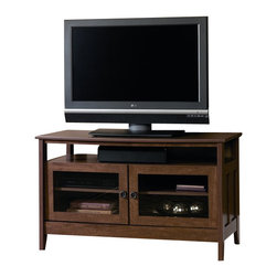 Sauder - Sauder August Hill Panel TV Stand in Oiled Oak - Sauder - TV Stands - 409636 - Inspired by antiques and heirlooms the arts and crafts influenced design of August Hill is like finding a reassured piece from historic home magically updated to serve today's changing needs and lifestyles. The warm Oiled Oak finish plays well with any home decor and existing woodwork enabling August Hill to blend in or stand alone as an accent.