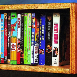 Wood Shed - Desktop Media Storage (Unfinished) - Finish: UnfinishedOne shelf. Capacity: 26 CD's or 22 DVD's or 12 VHS. Made from solid oak. Honey oak finish. 14.25 in. W x 7 in. D x 9.5 in. H