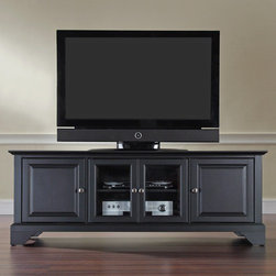 """Crosley - LaFayette 60"""" TV Stand - Enhance your living space with Crosley's impeccably-crafted Low Profile TV stand. This signature cabinet accommodates most 60'' flat panel TVs, and is handsomely proportioned featuring character-rich details sure to impress. Perfect for blending with the family of furniture that is already part of your home. Panel doors strategically conceal stacks of CD/DVDs, and various media paraphernalia. Tempered glass doors not only add a touch of class; they protect those valued electronic components, while allowing for complete use of remote controls. Adjustable shelving offers an abundance of versatility to effortlessly organize by design, while cord management tames the unsightly mess of tangled wires. Style, function, and quality make this cabinet a wise choice for your home furnishings needs. Features: -Beautiful raised panel doors.-Three adjustable shelves.-Beveled tempered glass.-Adjustable levelers in legs.-Recommended TV Type: Flat screen.-TV Size Accommodated: 60"""".-Powder Coated Finish: No.-Gloss Finish: No.-Material: Hardwood and veneers.-Solid Wood Construction: No.-Distressed: No.-Drawers: No .-Cabinets: Yes -Number of Cabinets: 1.-Number of Doors: 2.-Door Attachment Detail: Pin hinge.-Interchangeable Panels: No.-Magnetic Door Catches: Yes.-Cabinet Handle Design: Knob.-Number of Interior Shelves: 1.-Adjustable Interior Shelves: Yes..-Scratch Resistant : No.-Removable Back Panel: No.-Hardware Finish (Finish: Black): Brushed nickel knobs, steel hardware.-Hardware Finish (Finish: Classic Cherry, Vintage Mahogany): Antique brass knobs, steel hardware.-Casters: No .-Accommodates Fireplace: No.-Fireplace Included: No .-Lighted: No .-Media Player Storage: Yes.-Media Storage: No .-Cable Management: Hole in back for wires.-Remote Control Included: No.-Batteries Required: No .-Weight Capacity: 200 lbs.-Swatch Available: No.-Commercial Use: No.-Collection: LaFayette.-Eco-Friendly: No.-Recycled Content: No .-Lift Mechanism: No.-Expandable: """
