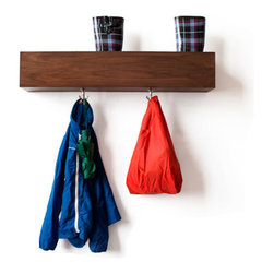 Arthur Coat Rack - Not your usual coat tree, this wall mounted rack is all about keeping the floor clean. With a number of storage cubbies and a few carefully placed hooks, all of your entryway storage should be taken care of.