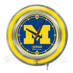 Holland Bar Stool - Holland Bar Stool Clk15MichUn Michigan Neon Clock - Clk15MichUn Michigan Neon Clock belongs to College Collection by Holland Bar Stool Our neon-accented Logo Clocks are the perfect way to show your school pride. Chrome casing and a team specific neon ring accent a custom printed clock face, lit up by an brilliant white, inner neon ring. Neon ring is easily turned on and off with a pull chain on the bottom of the clock, saving you the hassle of plugging it in and unplugging it. Accurate quartz movement is powered by a single, AA battery (not included). Whether purchasing as a gift for a recent grad, sports superfan, or for yourself, you can take satisfaction knowing you're buying a clock that is proudly made by the Holland Bar Stool Company, Holland, MI. Clock (1)