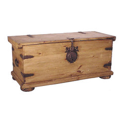 Mexican Artisans - Rustic Pine Trunk - Nothing says rustic charm like a pine trunk — which smartly serves as a coffee table as well as a storage solution. This piece, hand-crafted from solid kiln-dried pine, features disk feet and chunky iron hardware, perfectly suited to a Southwestern, cabin or desert decor.