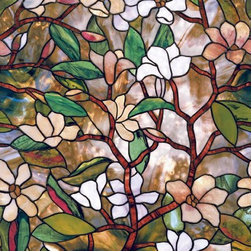 Home Decorators Collection - Magnolia Stained Glass Window Film - Our Magnolia Stained Glass Window Film captures the character of the southern magnolia tree and provides privacy with the look of real stained glass. The repeating pattern enables a vertical or horizontal fit that self adheres to any smooth glass surface. Made of a durable vinyl that can be removed in minutes and leaves no residue. Not affected by heat, cold, steam or humidity. Provides UV protection.