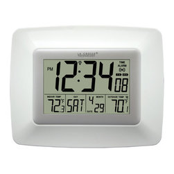 Lacrosse Technology - White Atomic Digital Wall Clock - La Crosse Technology Atomic Digital Wall Clock - WS-8119U-IT-W.  Self-setting atomic, easy to read clock with date and wireless in/outdoor temperature (�F/�C).  The wireless outdoor temperature sensor transmits a fast, reliable signal to the indoor clock giving you accurate outside temperature within a 260 ft range.  Transmitter is weather resistant and requires 2 AAA alkaline batteries (not included.) Calendar date can be read in 4 different languages: English, French, German, or Spanish and also features a time alarm with snooze. Lacrosse Technology - WS-8119U-IT-W