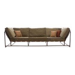 Stephen Kenn - The Inheritance Collection Sofa - Composed of a steel welded frame with a marbled, rust brown finish, custom webbing belts, smooth leather straps and re-purposed WWII military fabric for the cushion covers. The design is simple, comfortable, and conducive to conversation.