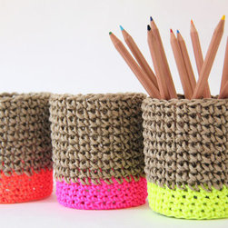 Covered Pot with Neon Base by Crayon Chick - These crocheted glasses have a fabulous neon at the bottom that gives the most unexpected pop of color to the raw, organic jute sleeve. Use them as vases or office organizers.