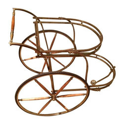 Rare Antique Vintage Wood & Solid Brass Tea Cart - This large unique piece is in it's original state of patina.  Solid Brass with wood for the spokes and handle. The piece has been untouched in it's aging process and although functional would be a great decoration piece instead. The arm in the center sways back and forth helping the cart turn more freely in an oddly fashion. The brass has tarnished due to age.  There's also oxidation as well which adds to it's unique antique character. Includes 2 glass panels for shelving. A few original bolts have been replaced.