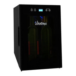 Vinotemp - Vinotemp VT-8TEDTS-ID 8 Bottle Thermoelectric Wine Cooler - VT-8TEDTS-ID - Shop for Wine Refrigerators from Hayneedle.com! Its compact size and versatile black finish make the Vinotemp VT-8TEDTS-ID 8 Bottle Thermoelectric Wine Cooler a perfect counter-top wine cooler. The unit holds eight bottles with two wire shelves and indoor storage. With its tinted glass door and exterior touch-screen control panel this unit is simple and stylish.About VinotempBased in Southern California since 1985 Vinotemp has proudly crafted custom built wine coolers for some of the finest restaurants and homes in the world. They've sold over 250 000 beautiful wine cellars in the United States and overseas. With a focus on quality value and service first implemented by founder Francis Ravel Vinotemp continues the tradition of creating innovative storage solutions for your fine wine.