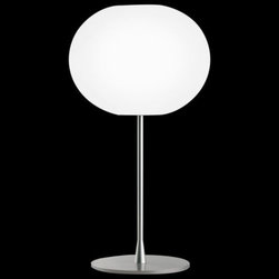 Flos Lighting - Glo-Ball T2 Table Lamp by Flos Lighting - Simple, silver and stylishly spherical. The Flos Glo-Ball T2 Table Lamp features the best in clean, contemporary design with a large hand-blown and acid-etched Opaline glass shade glowing brightly atop a Silver-finished steel base. Also available as the smaller Glo-Ball T1 Table Lamp. Part of the Flos Glo-Ball collection, designed by Jasper Morrison.Flos was first established in 1962 in Merano, Italy, to produce high quality modern lighting. This Italian lighting company continues to do so to this day by collaborating with talented international designers and researching the latest lighting technologies and materials. Resulting Flos lighting fixtures are daring and provocative, yet uphold the fundamental principles of good design.The Flos Glo-Ball T1 Table Lamp is available with the following:Details:Hand-blown, acid-etched, flashed Opaline glass shadeSteel baseSilver finish10' polarized power cordIn-line full range dimmerUL ListedMade in ItalyDesigned by Jasper Morrison, 1998Lighting:One 150 Watt 120 Volt T10 Halogen lamp (included).Shipping:This item usually ships within 3 to 5 business days.