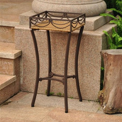 International Caravan - Outdoor Plant Stand - Indoor and outdoor use. Durable frame. Water resistant. UV light fading protective coating. Coated matte frame. Made from wicker resin and steel frame. Honey pecan finish. Assembly required. 12 in. W x 12 in. D x 26 in. H (7 lbs.)