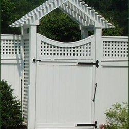 Gabled Arbor and Board Gate - A distinctive angle on the arbor and a graceful curve atop the gate combine to make a handsome impression on the landscape. The gable has tightly spaced lathing that creates a more sheltered look.