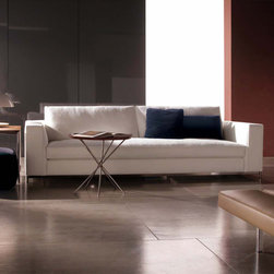 Minotti - Minotti Albers Sofa - Simple, smart, and contemporary. The Albers sofa can boast a linear design, as typical with urban glamour, suiting any room because of its unique character. The feet are available in two different sizes: standard base and high base. The metal finish is a light nickel-titanium. Backrest cushions available in two different options. The Albers Classic backrest cushion has a simple and comfortable design and the Albers Style backrest cushion varies in size for exciting combinations. Cushions padded with goose down with a polyurethane foam insert. Sofa available in five sizes. Uphostery finish in fabric or leather. Price includes shipping to the USA. Manufactured by Minotti.