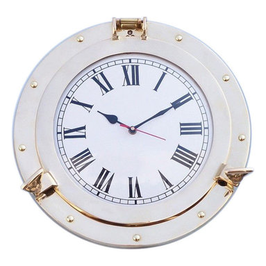 """Handcrafted Model Ships - Brass Porthole Clock 14"""" - Brass Porthole Clock - A classy and quality accent to any nautical themed room, the Hampton Nautical brass porthole clock is made of polished solid brass and features Roman numerals with 15-minute intervals. With a functional hinge and two twist screws, this porthole clock opens to reveal the mechanism and to enable you to change the time or batteries. Solid Brass no plastic parts Polished Lacquer Finish for a shine without tarnish or fading Pre-Drilled Holes for easy mounting Porthole Actually . Opens change time without removing from wall"""