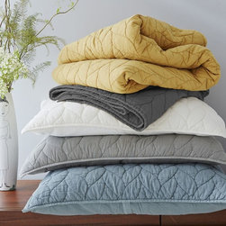 Braided Quilt - I love the idea of having a quilt or coverlet resting on the end of the bed. The layers are dream inducing and also make the design practical for the fall and winter months.