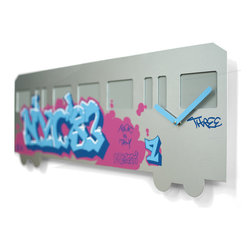 Progetti - NYC83 2210 Wall Clock - New York Sound is a collection of clocks designed by David Tonizzo based on three important musical movements that have traveled the world and characterized film and culture of the American metropolis. NYC83 is inspired by hip hop, movement, at its peak in 1983, based on rap, break dancing, Djing, and graffiti. The train that runs through the town had turned into an ideal object for Writers who drew elaborate names or messages made up of letters and numbers, which were taken throughout the city. It has wagon train shape with windows in bas-relief and colorful graphics of NYC�۪83. Made in steel. Battery quartz movement.