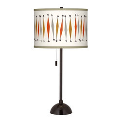 "Ragnar - Contemporary Tremble Giclee Glow Tiger Bronze Club Table Lamp - Add style to your favorite room with this club style table lamp. The lamp comes in a tiger bronze finish and has a slim profile perfect for seating areas bedrooms and more. Up top a beautiful Tremble pattern designed by Southern California retro-modern pop artist and illustrator Ragnar is printed onto a sleek drum shade. An on-off pull chain hangs below the shade within easy reach. U.S. Patent # 7347593. Club style table lamp. Tremble pattern printed drum shade. Tiger bronze finish. Maximum 100 watt or equivalent bulb (not included). On/off pull chain. 28"" high. Shade is 13 1/2"" across the top and bottom 10"" high.   Club style table lamp.  Tremble pattern printed drum shade.  Tiger bronze finish.  Maximum 100 watt or equivalent bulb (not included).  On/off pull chain.  28"" high.  Shade is 13 1/2"" across the top and bottom 10"" high."