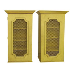 Pre-owned Vintage Cabinets with Metal Wire Mesh Doors - Pair - A pair of 1970s lime/yellow tall cabinets with iron see through mesh wiring that reveal the contents of anything you choose to store and display on the 4 shelves. The shade hardware is intact on the back of the front doors. They are versatile and attractive enough to store anything you choose. They make great side tables and are perfect for a bathroom,  living room or even the kitchen.