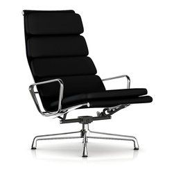 "Herman Miller - Herman Miller Eames Soft Pad Lounge Chair - Stretch out in serious style with this amply padded lounge chair, perfect for catching a few zzz's, watching the big game or reading the latest bestseller. Designed by the iconic duo of Charles and Ray Eames, it's a quiet departure from those they typically created for the office environment. This lounge chair has a permanent recline and a longer back to give it a more ""stretched out"" feel."