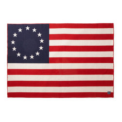 Faribault Woolen Mill Co. - Betsy Ross Flag Wool Throw - We're proud to produce all our goods under one roof right here in the heartland of The United States of America. To show our pride we've created a throw that salutes Betsy Ross' original handiwork. The 1776 throw combines comfort and patriotism in one plush yet durable keepsake. The surprisingly deep, bold colors and vivid patterns are made possible by our proprietary construction technique (similar to that used in our Revival Stripe blanket). Wrap yourself in truly American comfort. 85% soft-loomed fine merino wool and 15% cotton. Permanently moth-proofed.