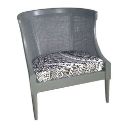 Used 70s Vintage Cane Chair - A vintage 1970s cane chair with elegant Greek style detailing and a cane back. This chair has been newly painted and reupholstered in vintage Decorators Walk fabric. The fabric is in a deep grey and white design. There are a couple of spots where the cane is broken, but it is not very noticeable.