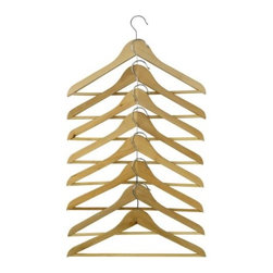 BUMERANG Curved clothes hanger - Being organized is not only more functional, it is more pleasing to the eye. For an easy fix, try replacing all of your wire hangers with these inexpensive wooden hangers from Ikea. They work great and will give a more uniform and put-together look to your closets.