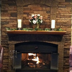 Fireplace Design Concepts - Faux stone keystones add a dramatic touch to this fireplace renovation, which features our Dakota Stonewall faux panels in Sierra Brown and Universal Keystones.
