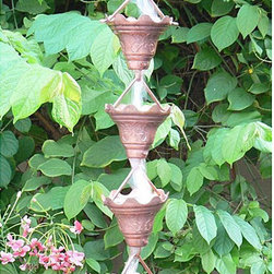 Monarch - Butterfly Scallop 8.5-foot Cupped Copper Rain Chain - Create an enchanting and warm outdoor ambiance with a copper rain chain Beautiful cups are adorned with scalloped edges and feature butterfly impressions Rain chain will instantly change the look of your garden or patio