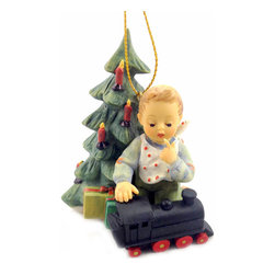 M I Hummel - M I Hummel Full Speed Ahead Ornament - This young boy is already playing with his new present right next to his Christmas tree. What a great ornament to hang yours.
