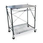 """InterMetro Industries - Metro Mobile Folding Table - This versatile work table features a solid top with a wire bottom shelf.  It provides a work space where you need it and when you need it. Two swivel casters and two casters with brakes make it easy to move, yet stable once in place.  When not in use this unit folds to 3"""" wide.  Work surface is made of type 304 Stainless Steel. Posts and bottom shelf are chrome plated.  Use it adjacent to your outdoor barbeque or kitchen counter, or as a free-standing beverage/condiment bar, a sampling table, a special hobby space, or simply place it in the back of your car for transport to a remote location.  Uses are only limited by your imagination."""