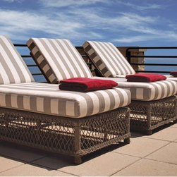Lloyd Flanders - Lloyd Flanders Vineyard Chaise Lounge Collection Multicolor - FLAN585 - Shop for Chaise Lounges from Hayneedle.com! Laying out by the pool is all about enjoying fresh air the sun and the beauty of nature; and there's no better way to do all of that than with the Lloyd Flanders Vineyard Chaise Lounge Collection. Inspired by the natural beauty of the Napa Valley these chaise lounges are ideally suited for relaxing in your yard with two friends while the three of you soak in some sun and the intoxicatingly fresh summer air. Its intricately woven wicker is reminiscent of the lush grapevines from the bucolic California countryside - a style that mirrors the sophisticated detail in the region's art and architecture. The thick cushions and sturdy multipositional base allow you either to sit comfortably while enjoying a good book or magazine or to stretch out for a little cat nap. And by adding a glass of wine and a friend to share the day with you can let your worries entirely melt away.The Comfort Plush cushions that come standard with the Vineyard Collection by Lloyd/Flanders will support you with their internal spring bond premium core with dense foam and special polyester fiber that ensure total relaxation. Wrapped around this high-quality core is a polypropylene jacket of spun-bond fabric that sandwiches a hydrophobic inner meltblown-fabric layer - an absolute must for any outdoor furniture.The attractive frames of the Vineyard collection boast finely wrought lattice bodies that recall the detailed trelliswork for supporting heavy grapevines. The woven vinyl not only adds a classic resort feel to the pieces in this collection but also provides you with peace of mind knowing that the high-quality construction will last season after season. The rattan peel is hand crafted using 100 percent virgin vinyl with added UV inhibitors making this furniture even more durable and beautiful than pieces made with natural fibers. And its rustic Beach Teak finish wil