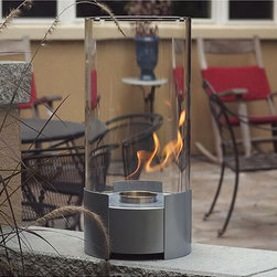 Nu-Flame - Nu-Flame Caldo Portable Fireplace - This decorative indoor fireplace is certain to be your favorite center piece. Standing 20 inches tall this impressive portable tabletop fireplace features a brushed stainless steel base and stunning tempered glass cylinder encasing the flames.